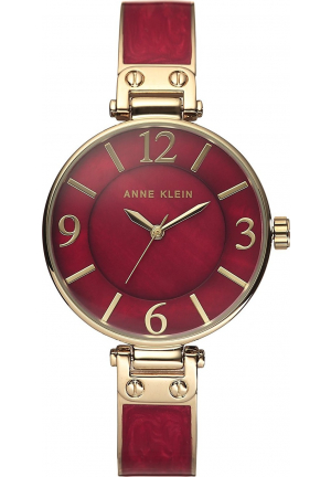 ANNE KLEIN GOLD TONE AND BURGUNDY ENAMEL WATCH 34MM